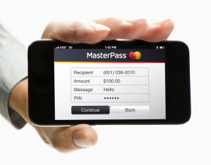 A person holding a mobile phone with MasterPass from MasterCard on it