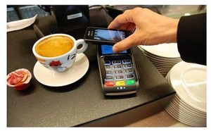 A contactless mobile phone making an NFC payment