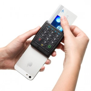 A phone with a Verifone Chip and PIN reader attached
