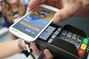 A smartphone making a Visa mobile contactless payment