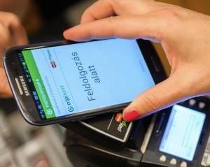 A mobile phone making a contactless payment