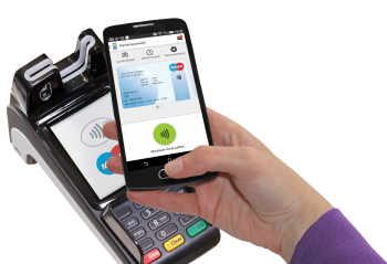 A mobile phone at an NFC POS using a mobile debit card